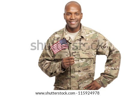 Happy serviceman holding an American flag - stock photo