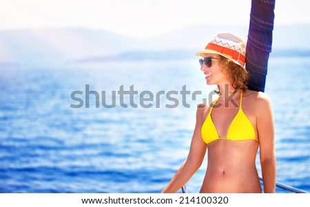 Happy sexy girl enjoying sea cruise, relaxation outdoors on the yacht, luxury summertime vacation, pleasure and enjoyment concept - stock photo