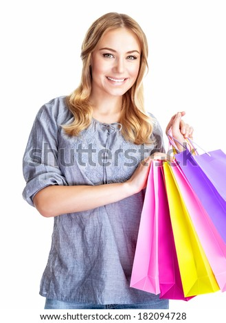 Happy shopper girl with four colorful paper bags isolated on white background, doing purchase, sale and spending money conception  - stock photo