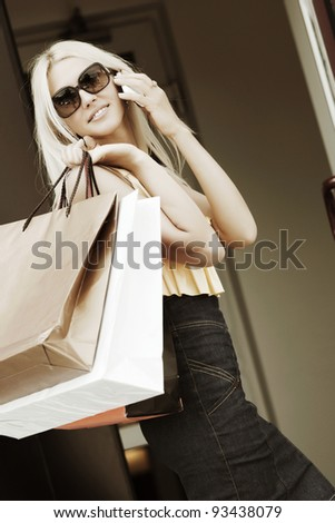 Happy shopper on the phone - stock photo