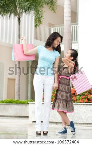 Happy shoppers holding purchases in the store
