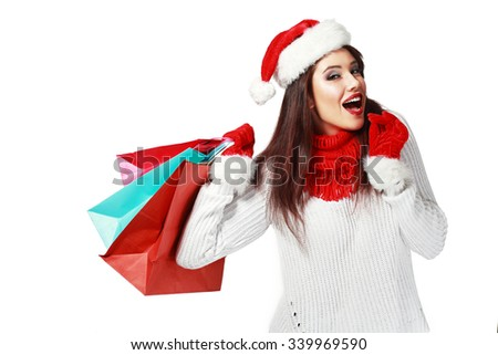 Happy shopping Christmas woman with bags - stock photo