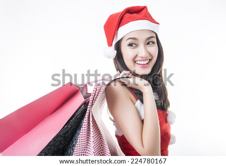 Happy shopping Christmas woman with bags  white background