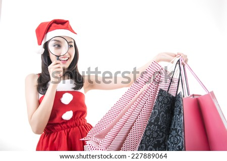 Happy shopping Christmas woman with bags white background  - stock photo