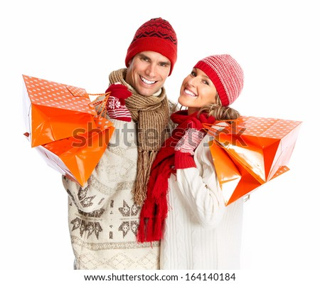 Happy shopping couple with bags. Isolated  white background. - stock photo