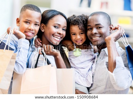 Happy shopping family smiling together at the mall