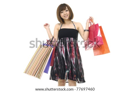 happy shopping girl holding colorful  bags