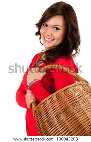 happy shopping girl with wicker basket, white background