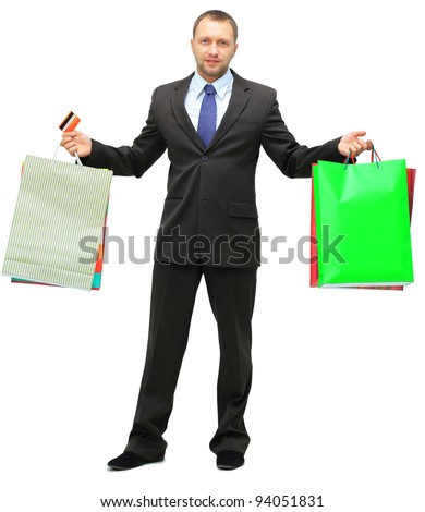 Happy shopping man. Isolated over white background - stock photo