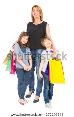 Happy shopping mother and daughters smiling isolated on white background - stock photo
