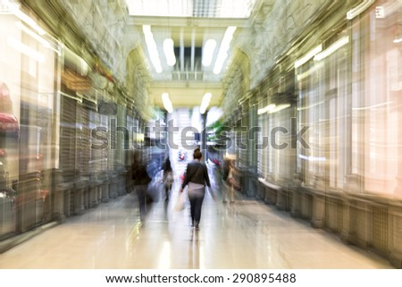 Happy shopping, shopping spree in city, motion blur, zoom effect - stock photo
