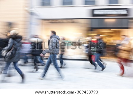 Happy shopping, shopping spree in city, people walking, motion blur - stock photo