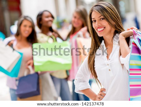 Happy shopping woman at the mall with her friends