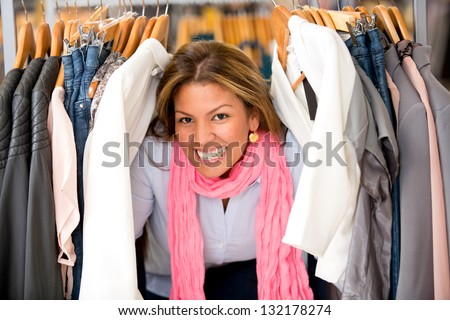 Happy shopping woman buying clothes in a store - stock photo