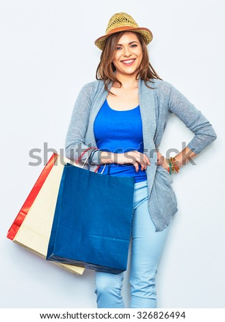 Happy Shopping woman holding bags. beautiful smiling girl portrait on white studio wall background. one woman portrait. - stock photo