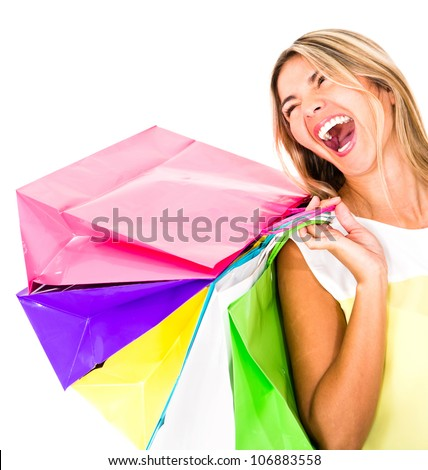 Happy shopping woman laughing - isolated over a white background