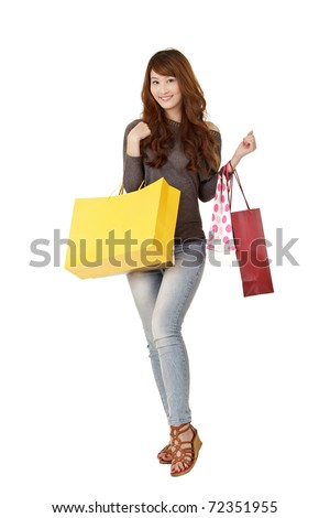 Happy shopping woman of Asian holding bags, isolated on white background. - stock photo