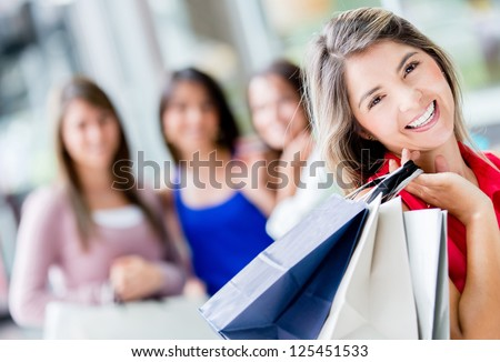 Happy shopping woman with a group of friends
