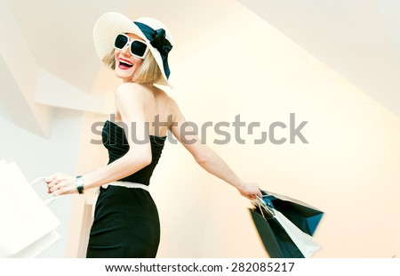 Happy Shopping Woman with shopping bags in motion