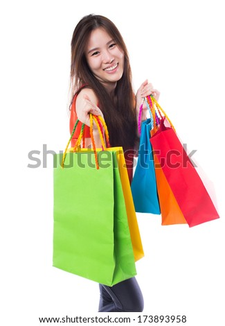 Happy shopping woman with shopping bags on white background
