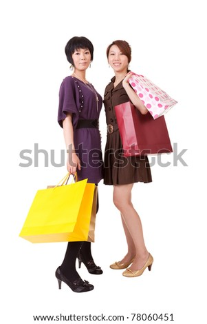 Happy shopping women, full length portrait isolated on white background.