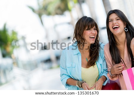 Happy shopping women having fun and laughing - stock photo