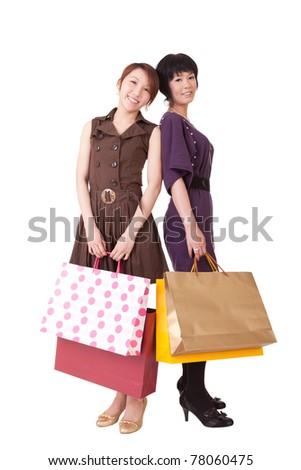 Happy shopping women holding bags, full length portrait isolated on white background. - stock photo