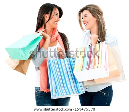 Happy shopping women talking - isolated over a white background  - stock photo