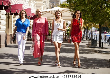 Happy shopping women walking at the red square in Moscow - stock photo