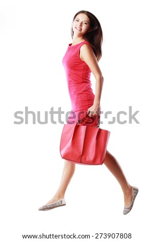 happy shopping young woman running hold red back or purse - isolated on white background - stock photo