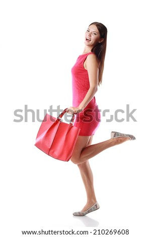 happy shopping young woman running hold red back or purse - isolated on white background, full body, asian model  - stock photo