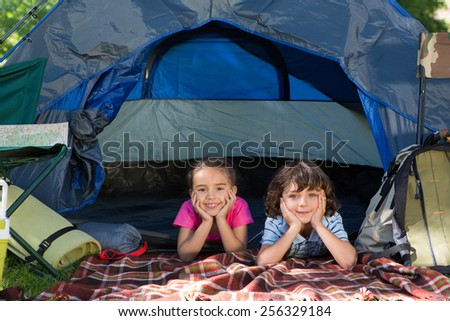 Happy siblings on a camping trip on a sunny day - stock photo