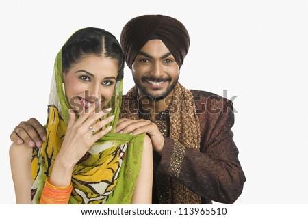 Happy Sikh couple smiling - stock photo