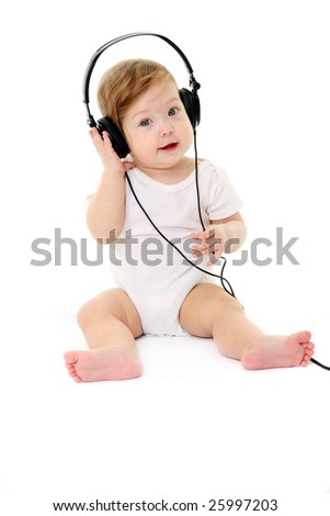 Happy singing baby wearing big black headphones