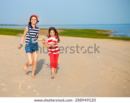 Happy sister playing on beach at the sunrise time