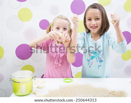 Happy sisters make cake in kitchen