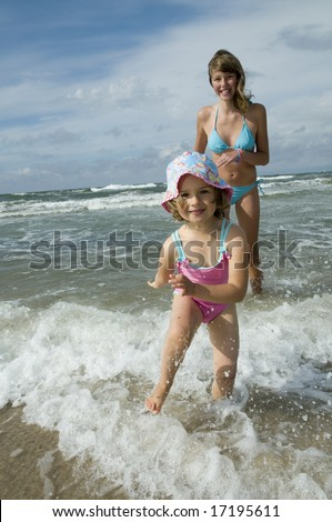 Happy sisters playing on the beach
