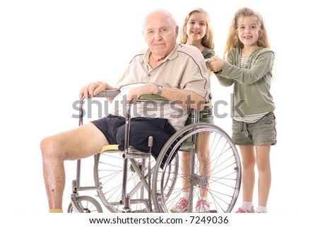 happy sisters pushing eldery man in wheelchair - stock photo