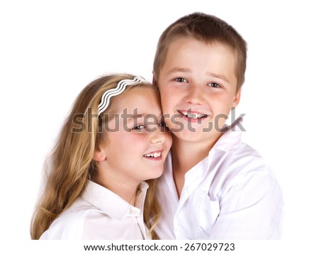 Happy siting and laughing  preschool boy and his sister on white background.