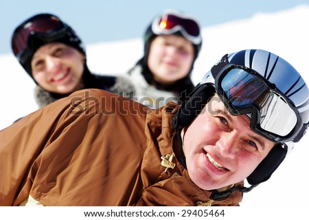 Happy skiers resting on ski resort - stock photo