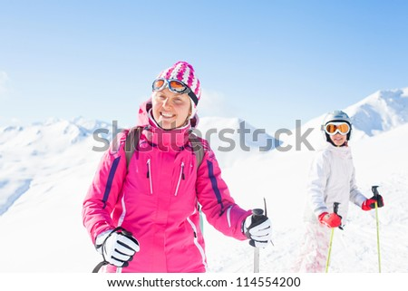 Happy skiers. Smiling woman with her daughter, Zellertal, Austria - stock photo