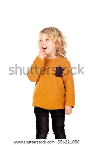 Happy small blond child with red jersey isolated on a white background