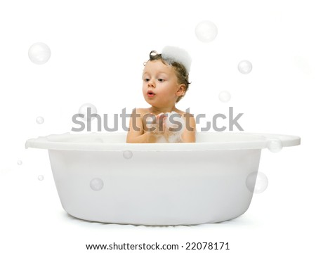 Happy small boy having bath. Isolated over white