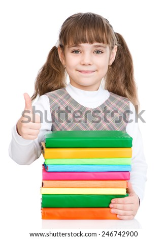 happy small girl with pile books showing thumbs up. isolated on white background - stock photo