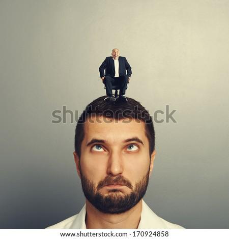 happy small man rolling on the head big man - stock photo