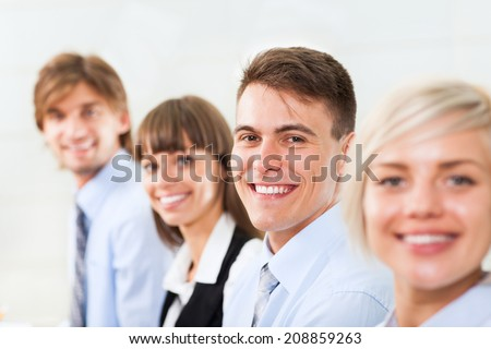 happy smile business woman and man face selective focus, people group in a row, young businesswoman looking at camera, businesspeople team sitting at desk in office