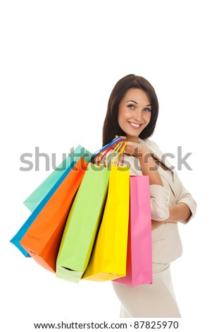 Happy smile business woman holding colorful shopping bags isolated over white background - stock photo