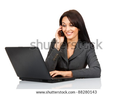 happy smile business woman sitting at the desk using laptop looking at screen, call on cell phone, isolated over white background