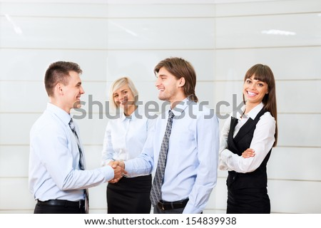 happy smile businessmen handshake standing at office, businesspeople hand shake, business people congratulating men partner, meeting at conference hall - stock photo