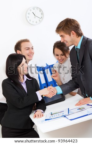 happy smile businesspeople handshaking at office desk, businessman and businesswoman shaking hands with partner in meeting or signing contract, set deal